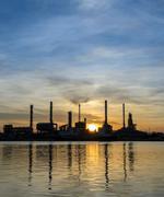 Oil refinery or petrochemical industry plant at sunrise Kuvituskuvat