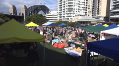 Outdoor market by Sydney Harbour bridge - stock footage