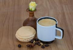Coffee with macaroons and rose Stock Photos