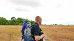 Man tourist looks in binocular in  outdoor place in yellow field. 4K 3840x2160 Stock Footage