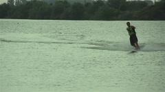 Man waterskiing in Lake sprayed water in slow motion Stock Footage
