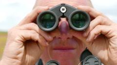 Man tourist looks in binocular . Compilation from three scenes 4K 3840x2160 Stock Footage
