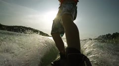 water skiing in the  mountain lake at sunset in slow motion - stock footage