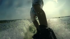 Water skiing in the lake at sunset in slow motion Stock Footage