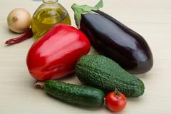 Eggplant, cucumber, avocado and red pepper Stock Photos