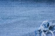 Stock Photo of Old torn jeans texture. Textile background