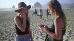 Teens talking on cell phones - stock footage