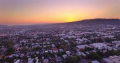 Aerial view city Los Angeles, West Hollywood, Beverly Hills at sunset. 4K UHD Stock Footage