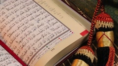 Pan across open pages of the Holy Koran Stock Footage