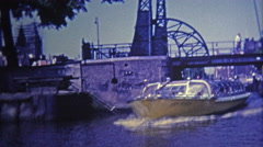 1969: Ride on boating canals and past classic bridges. Stock Footage