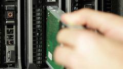 IT technician install hard drive in blade server Stock Footage