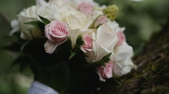 Beautiful bridal bouquet lying on the tree 2 Stock Footage