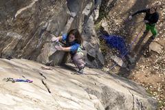 Pair of female climbers assault the rock wall Stock Photos
