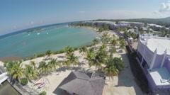 Flight into beach resort in Jamaica - stock footage