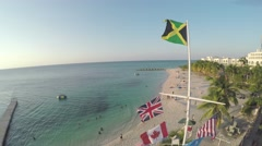 Flight around Jamaican flag Stock Footage