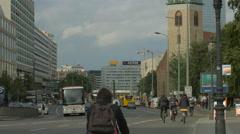 Riding bikes on Karl-Liebknecht Street in Berlin Stock Footage