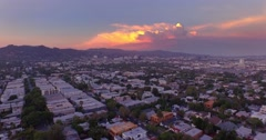 Aerial view city of Los Angeles, West Hollywood sunset camera flying forward 4K Stock Footage