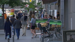 People walking on the sidewalk on Friedrichstraße, Berlin Stock Footage