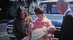 1969: Young mother has baby ready for baptism christening. Stock Footage