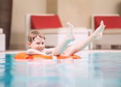 Swiming boy in pool Kuvituskuvat