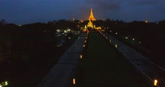 Night aerial 4k flight - forward and rising crane shot of Schwedagon pagoda Stock Footage