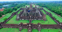 Stock Video Footage of low forward aerial towards Angkor wat