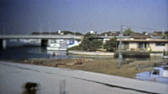 1969: Modern construction of contemporary architecture style in trendy area of Stock Footage