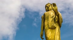 4K Time Lapse. Gold Buddha Statue at Blue Sky with Clouds - stock footage