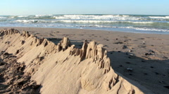 Sand castle against the seashore, Slow Motion - stock footage