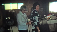 1974: Women fitted for kimono style fashion dress in her home. Stock Footage