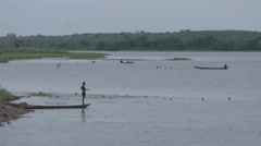 Stock Video Footage of Ghana Volta river fisherman desolate 4K