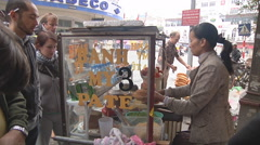 Woman cooking street food in Ho Chi Minh City, North Vietnam Stock Footage