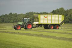 Transport of cut grass with tractor Stock Photos