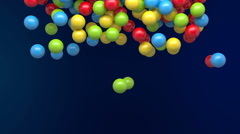 Falling colored balls - stock footage
