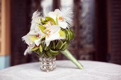 Elegant lily bouquet on table - stock photo