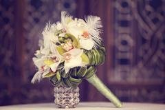 Elegant lily bouquet on table Stock Photos