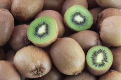 A few fresh kiwi fruits - stock photo