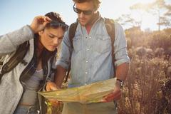 Hikers looking at map for navigation - stock photo