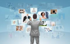 Businessman working with virtual screen Stock Photos
