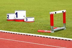 Stock Photo of Track lanes, winner's podium, hurdles