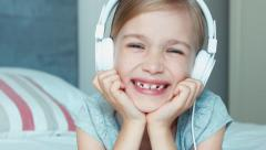 Closeup portrait girl listening music in headphones and singing a song Stock Footage