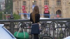 Girl taking pictures on Friedrichstraße bridge, Berlin Stock Footage