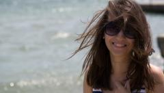 Portrait of a Woman With Glasses on the Beach  Stock Footage