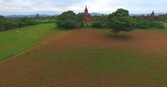 4k aerial - rising crane shot of stupas facing Ayeyanwaddy driver Stock Footage