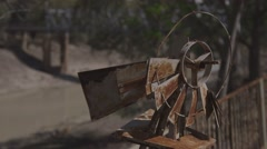 Abandoned broken wind generator on banks of muddy Darling River - stock footage