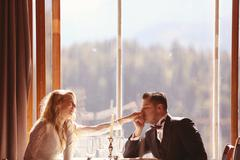 Affectionate bride and groom in the restaurant Stock Photos