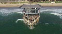 Aerial Footage over ocean of Moyo Pier Stock Footage