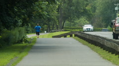 Jogger and Cyclists on Farmington Canal Heritage Greenway Stock Footage
