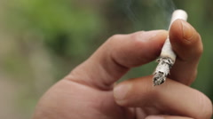 Cigarette in the Hands of a Smoker Stock Footage