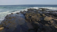 Aerial Footage of rocky shore and waves Stock Footage